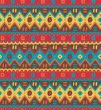 L'ornamentale indigeno decorativo luminoso del tessuto etnico ha barrato il modello senza cuciture Fotografie Stock