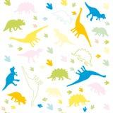 L'ornement des silhouettes multicolores des dinosaures Photographie stock