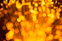 L'oro accende il fondo astratto Fotografie Stock