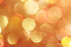 L'oro, argento, rosso, bianco, bokeh astratto arancio si accende, fondo defocused Immagini Stock
