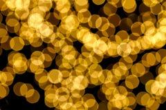 L'oro macchia la priorità bassa del bokeh Fotografie Stock Libere da Diritti