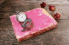 L'orologio e morto sono aumentato Fotografia Stock