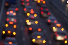 l'ostruzione illumina brillantemente il traffico brillante della coda Immagini Stock
