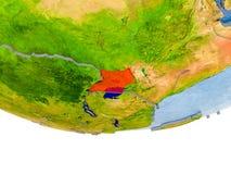 L'Ouganda en rouge sur le modèle de la terre Photo libre de droits