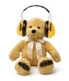 L'ours de nounours se reposant avec entendent des protecteurs Image stock