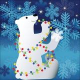L'ours de Polor a embrouillé dans des ampoules de Noël Photographie stock