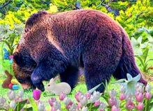 L'ours gris vit dans une forêt verte entourée par des signes de la belle saison de Pâques de venir photos stock