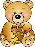 L'ours mange du miel Photo libre de droits
