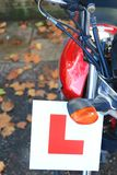 L plate on a motorbike Stock Image