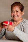 L'aîné prennent le café Images libres de droits