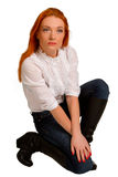 L red-haired girl in a white blouse Royalty Free Stock Photography