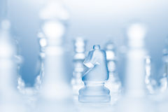 L-shaped move. A conceptual photo of a transparent knight on a chessboard making an l-shaped move Stock Photography