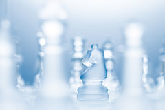 L-shaped move. A conceptual photo of a transparent knight on a chessboard making an l-shaped move Royalty Free Stock Photo