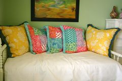 L Sofa Bed. White sofa bed with five colorful pillows, against Stock Photos