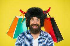 L?st om shopping Fulla packar av objekt För framsidakläder för man strikt hatt av tjuren med horn Shoppa för Hipster som är hemfa arkivbild