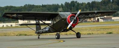 L5 Stinson. L-5 Stinson aircraft on runway Royalty Free Stock Photography