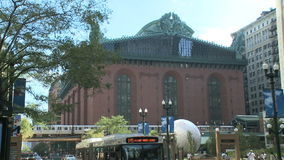 L Train arrives at Harold Washington Library in Chicago stock footage