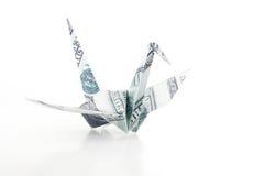 L'uccello di Origami fatto dalla banconota del dollaro Fotografia Stock Libera da Diritti