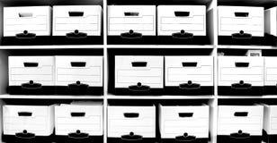 L'ufficio accantona in pieno degli archivi e delle caselle Fotografia Stock Libera da Diritti