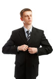 L'uomo abbottona un vestito Immagini Stock Libere da Diritti
