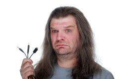 L'uomo adulto si addolora con un cavo Fotografia Stock Libera da Diritti