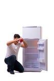 L'uomo affamato che cerca soldi per riempire il frigorifero Fotografia Stock