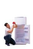 L'uomo affamato che cerca soldi per riempire il frigorifero Fotografie Stock Libere da Diritti