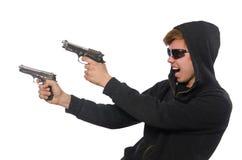 L'uomo aggressivo con la pistola isolata su bianco fotografia stock