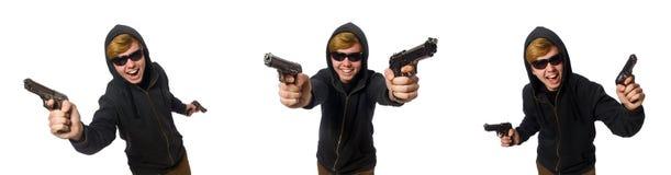 L'uomo aggressivo con la pistola isolata su bianco fotografie stock