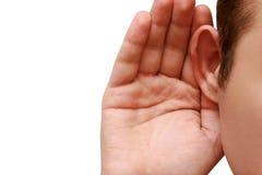 L'uomo ascolta pettegolezzo Fotografia Stock