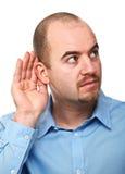 L'uomo ascolta posa fotografie stock libere da diritti