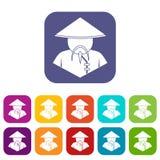 L'uomo asiatico nelle icone coniche del cappello ha messo il piano Fotografia Stock Libera da Diritti