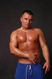 L'uomo in azzurro suda Fotografia Stock Libera da Diritti