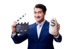 L'uomo bello con la valvola di film isolata su bianco Immagine Stock