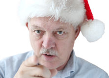 L'uomo in cappello di Santa sta guardandovi Immagine Stock