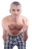 L'uomo cattivo con i pugni appiattiti Fotografia Stock