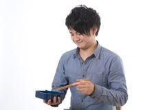 L'uomo che mangia un pranzo Fotografie Stock