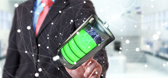 L'uomo che tocca 3D rende la batteria con fulmine con il suo dito Fotografie Stock Libere da Diritti