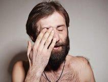 L'uomo con una grande barba ed i baffi Fotografia Stock