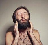 L'uomo con una grande barba ed i baffi Fotografia Stock Libera da Diritti