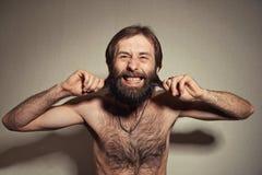 L'uomo con una grande barba ed i baffi Fotografie Stock