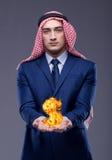 L'uomo d'affari arabo con il simbolo di dollaro bruciante Fotografie Stock