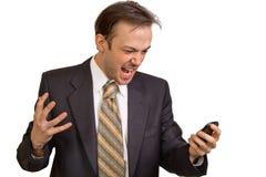 L'uomo d'affari arrabbiato grida al telefono Immagine Stock