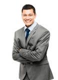 L'uomo d'affari asiatico arma sorridere piegato Fotografia Stock
