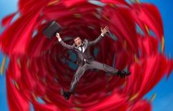 L'uomo d'affari cade in abisso Fotografie Stock