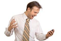 L'uomo d'affari in camicia bianca grida sul telefono Immagini Stock