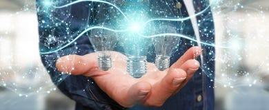 L'uomo d'affari che collega le lampadine moderne con i collegamenti 3D ren Fotografie Stock Libere da Diritti