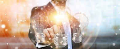 L'uomo d'affari che collega le lampadine moderne con i collegamenti 3D ren Fotografia Stock Libera da Diritti