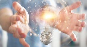 L'uomo d'affari che collega le lampadine moderne con i collegamenti 3D ren Fotografie Stock