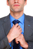 L'uomo d'affari che fa suo lega in su Immagine Stock Libera da Diritti